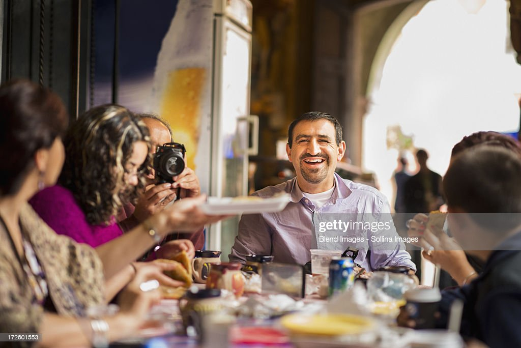 Family having dinner together at table : Stock Photo