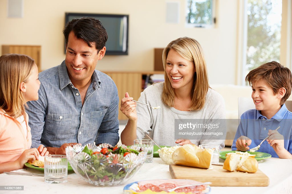 A family having dinner together  : Stock Photo