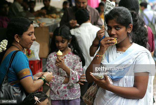 A Family having food from Street food vendor in Mumbai