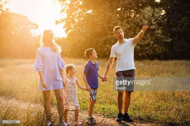 Family having fun in the nature in early autumn