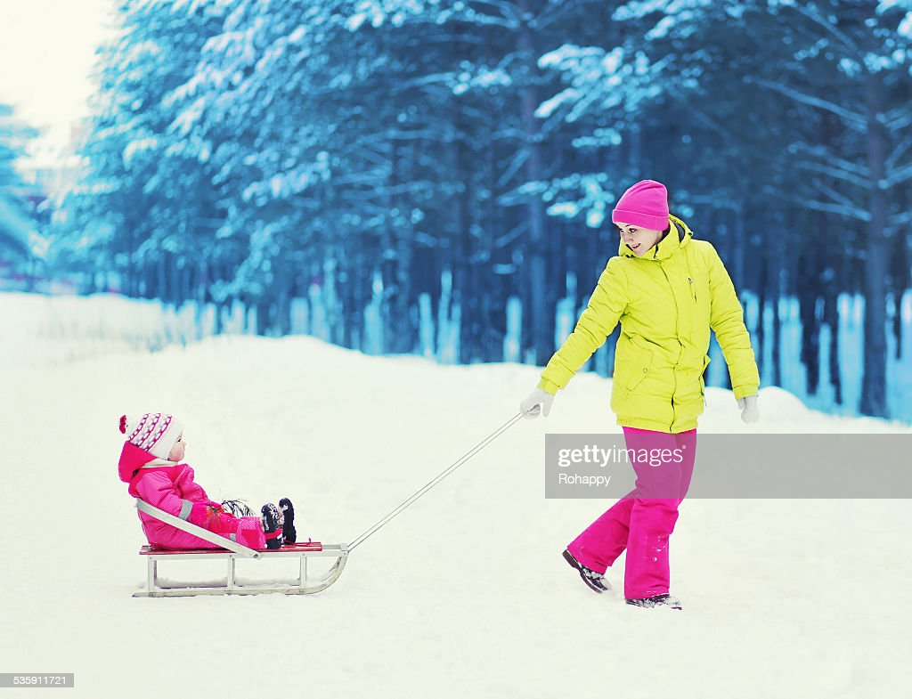 Family having fun in the winter day : Stock Photo