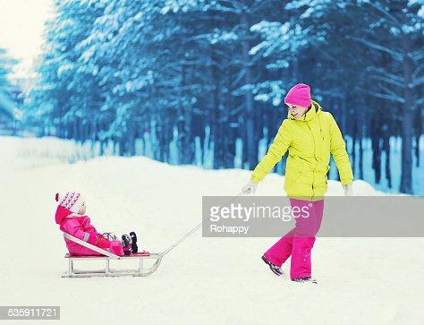 Family having fun in the winter day : Stock Photo