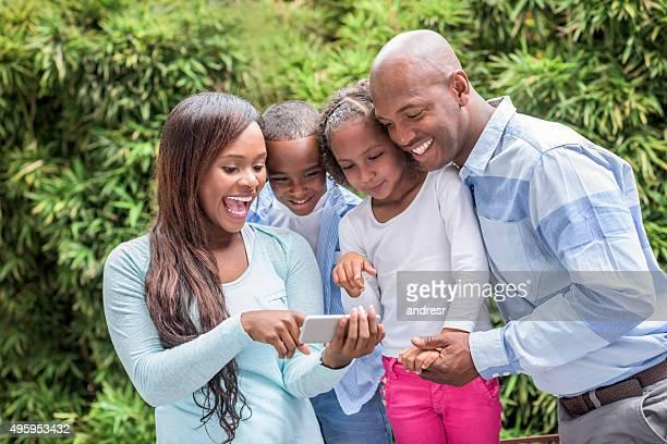 Family having fun looking at a selfie