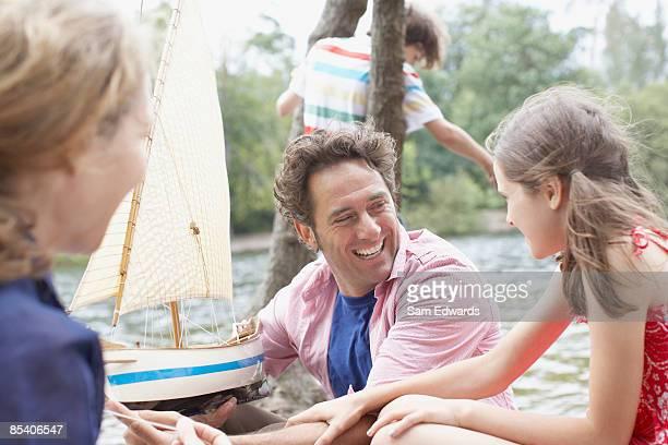 Family having fun near lake
