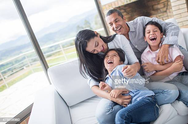 Family having fun tickling each other