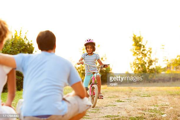 Family Having Fun With Bicycle Outdoors.