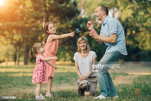 Family Having Fun With Bubbles.