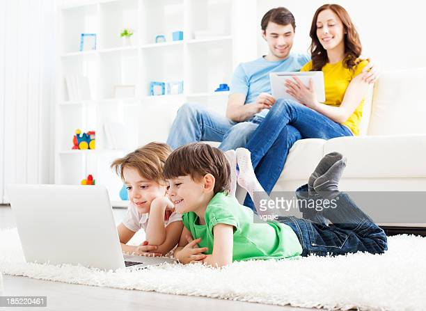 Family Having Fun with gadgets at home.