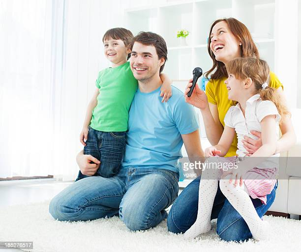 Family Having fun with karaoke