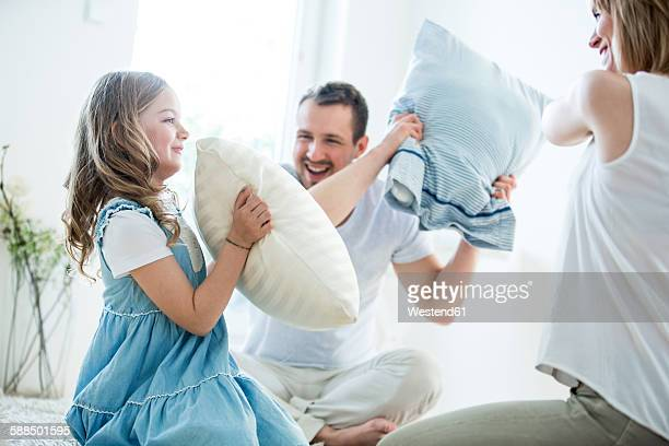 Family having fun with pillow fight