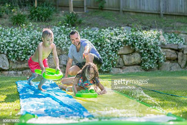 Family having fun with water