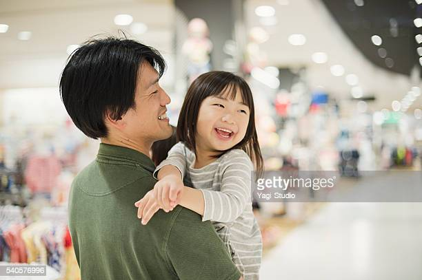 Family having good time in the supermarket.