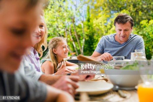 Family having healthy breakfast at table