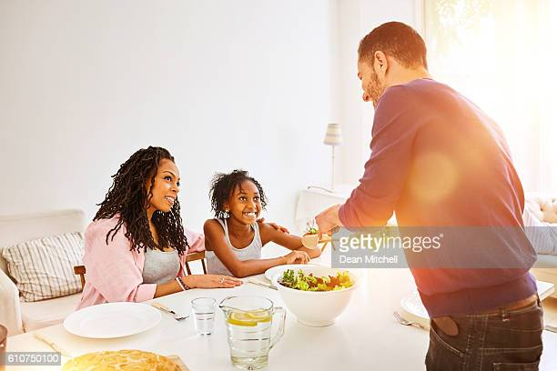 Family having lunch at the dining table