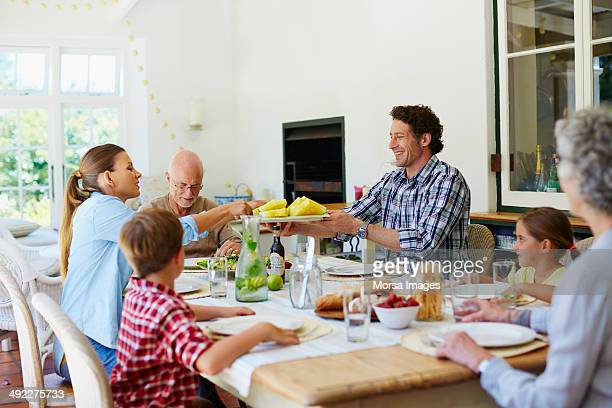 Family having meal at dining table