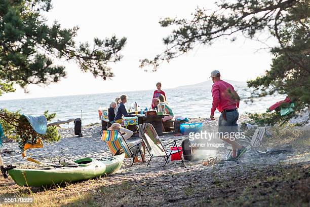 Family having meal on beach