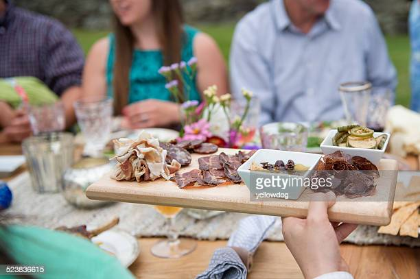 Family having meal together, outdoors