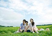 Family having picnic in field