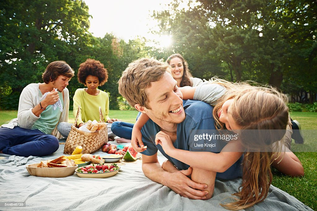 Family having picnic in park : Stock Photo