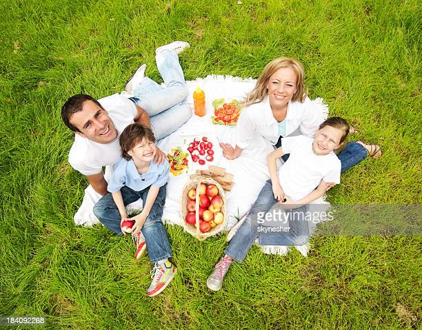 Family having picnic outdoor.