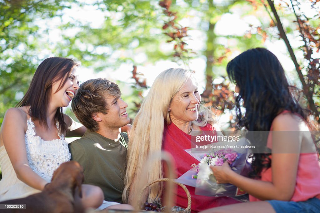 Family having picnic together : Stock Photo