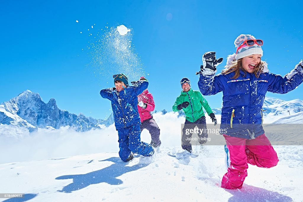 Family having snowball fight, Chamonix, France