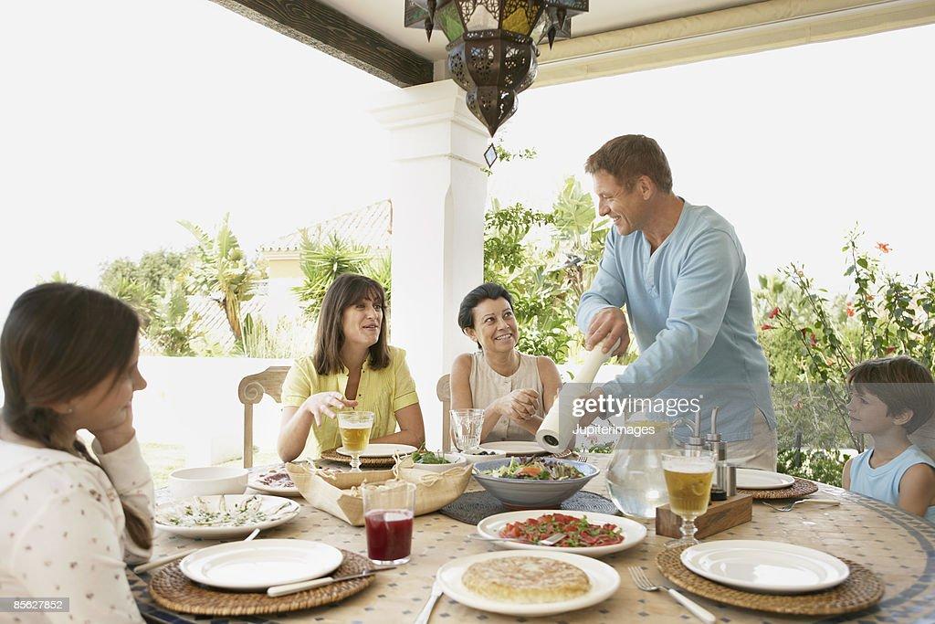Family having Spanish tapas lunch