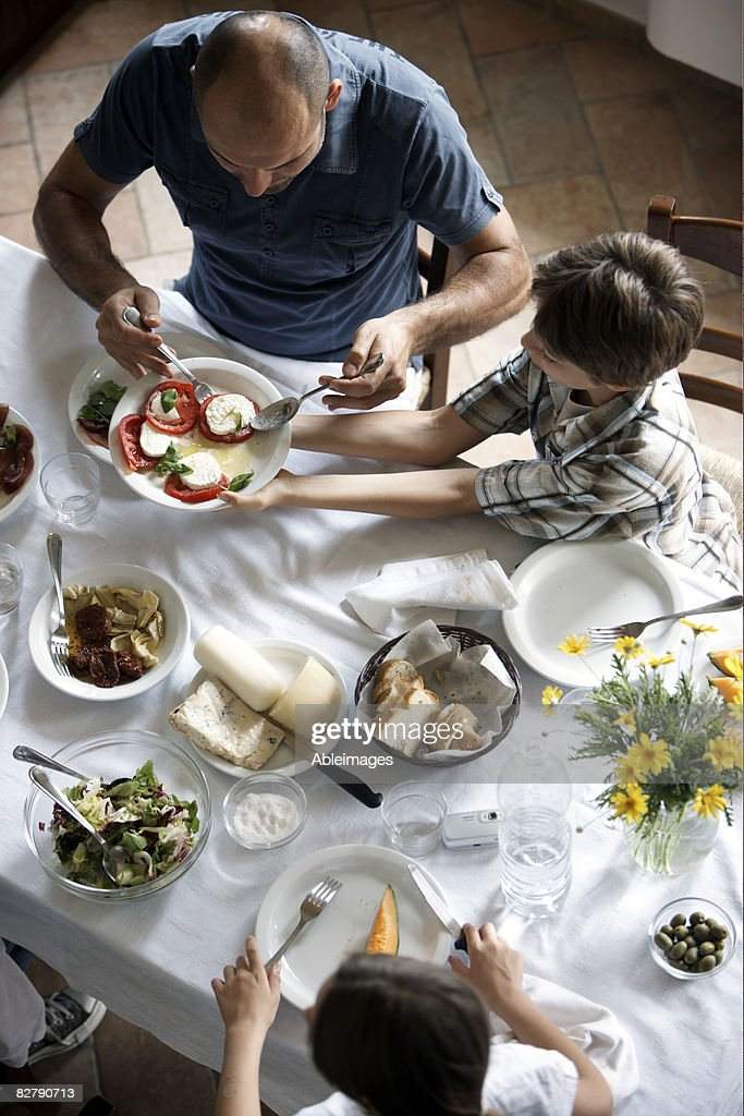 family having typcaly italian meal : Stock Photo