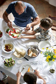family having typcaly italian meal