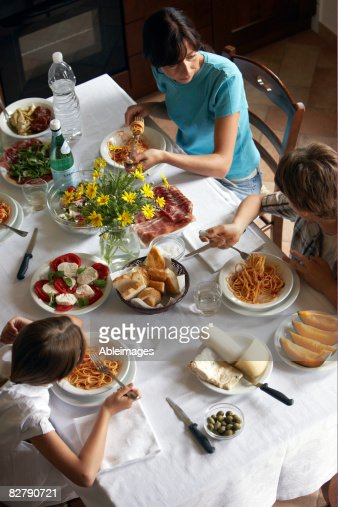 family having typical italian meal : Stock Photo
