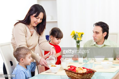 Family Heaving Cereals For Breakfast Stock Photo   Getty ...