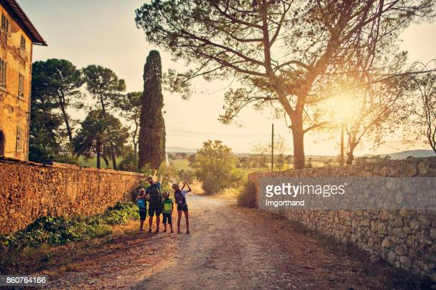Family hiking in Tuscany, Italy
