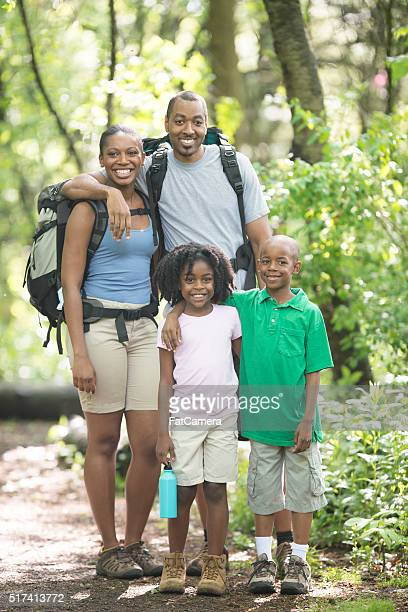 Family Hiking Through the Woods Together
