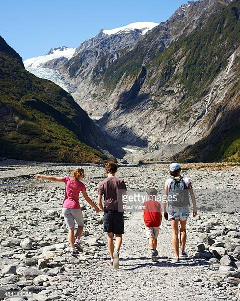 Family hiking to Franz Josef Glacier