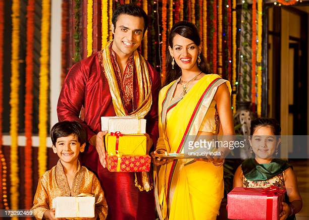 Family holding gifts on Diwali