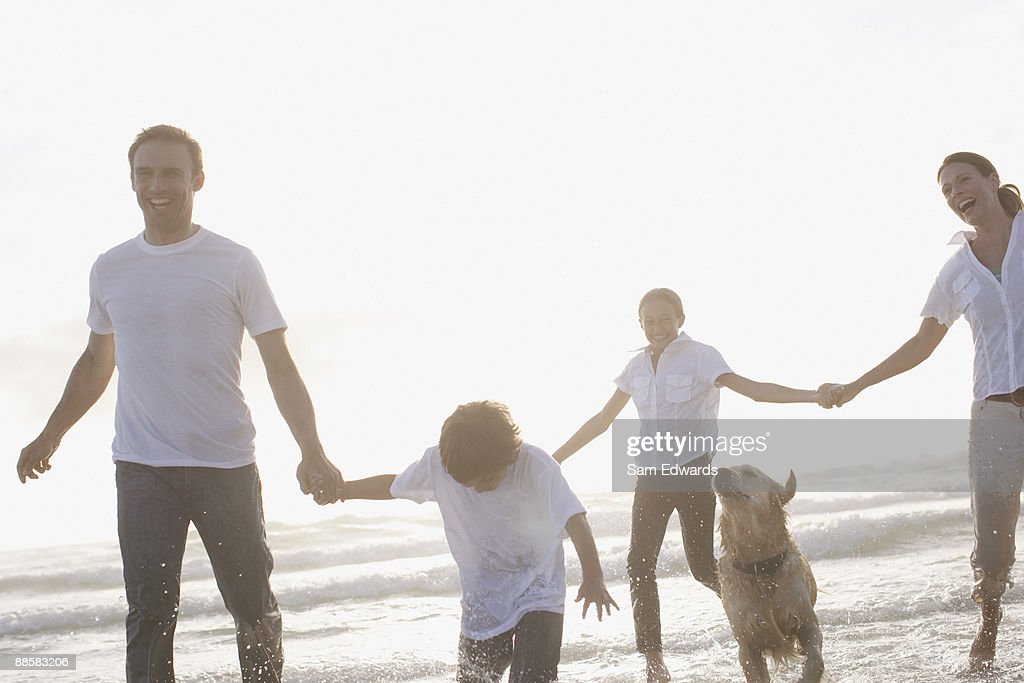 Family holding hands at beach : Stock Photo