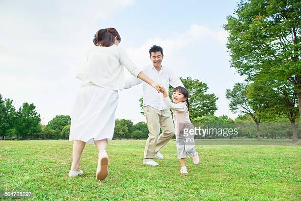 Family holding hands in a circle