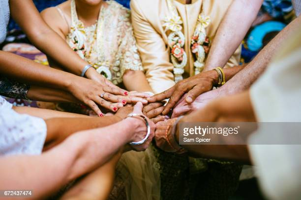 Family holding hands in Wedding Celebration, Thailand