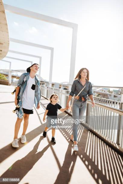 family holding hands on the street in Brisbane