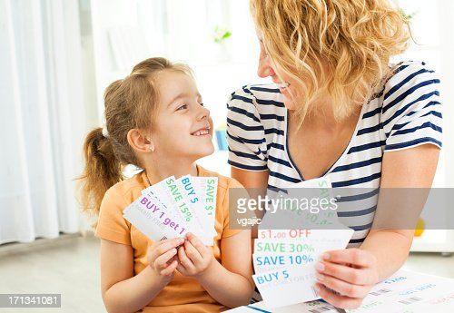 Family Holding shopping coupons.