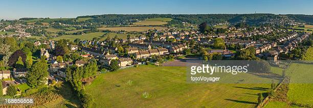 Family homes in green landscape aerial panorama
