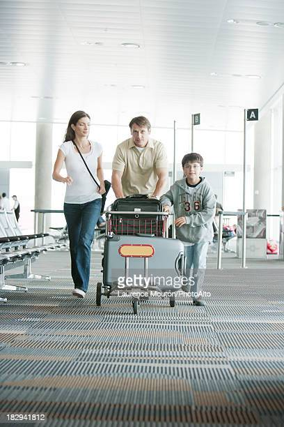 Family hurring through airport