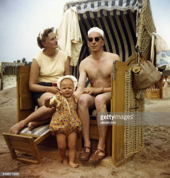 Family in a beach chair at the North Sea Cuxhaven