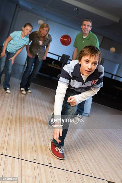 Family in a bowling alley.