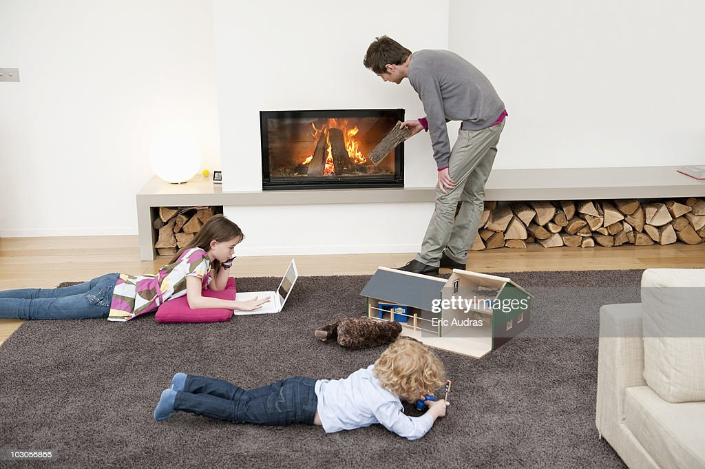 Family in a living room : Stock Photo