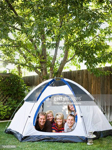 family in a tent in the backyard