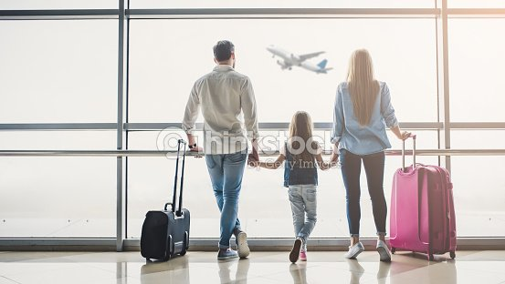 Family in airport : Stock Photo