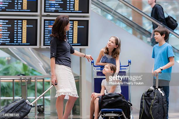 Family in airport with luggage