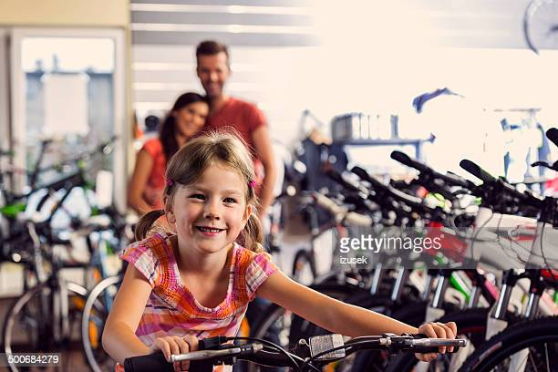 Family in bike store