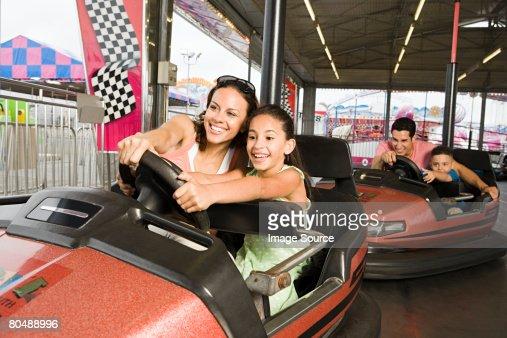 Family in bumper cars